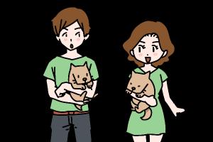 犬を抱き出会う男女